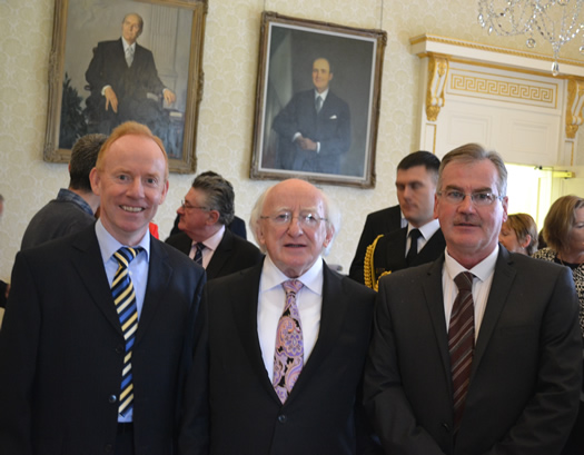 President Micheál D Ó hUiginn, Muiris Mac Dháibhéid, chairman of Newry Féile (R), and Seán Mac Labhraí, chairman of Ulster Féile and member of the national committee (L).