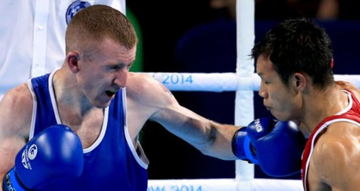 Commonwealth games light-flyweight gold medalist Paddy Barnes mid fight with Devendro Laishram