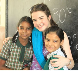 Aoife McGirr of St Mary's University College with two pupils from Sneha