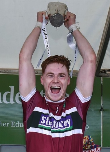 St Mary's team captain, Conor Meyler, raises the Sigerson Cup in victory