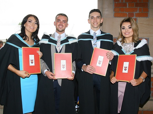 A group of St Mary's students with their degree certificates