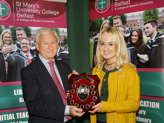Mr Jim Clarke, CEO of the Council for Catholic Maintained Schools (CCMS) presents an award to St Mary's student teacher Ciara Maguire from Garrison Co Fermanagh